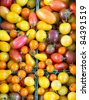 Freshly picked mixed cherry tomatoes on display in pint box containers at the farmer's market - stock photo