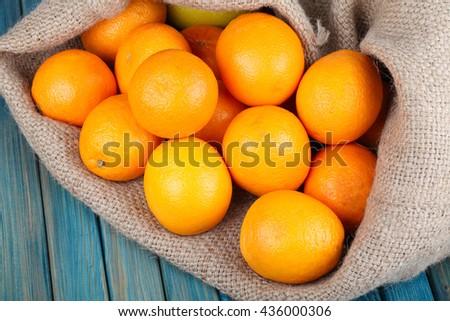Freshly Picked Oranges in Burlap Bag  - stock photo