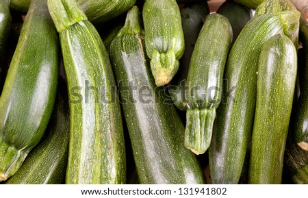 Freshly picked zucchini wallpaper - stock photo