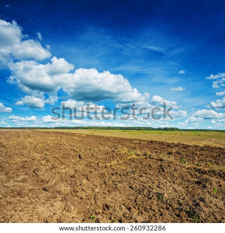 freshly plouged field in spring  - stock photo
