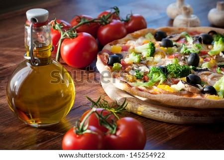 freshly prepared veggie pizza - stock photo