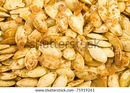 freshly roasted pumpkin seeds - stock photo