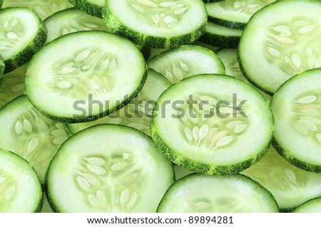 Freshly sliced cucumber - stock photo