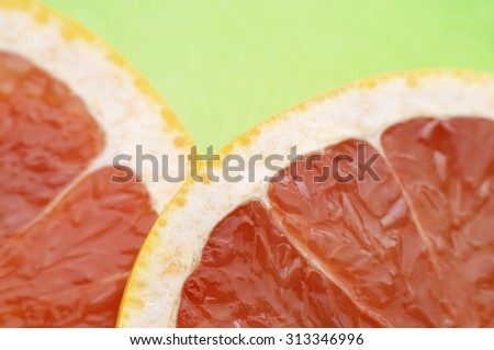 Freshly Sliced Grapefruit On Green Table