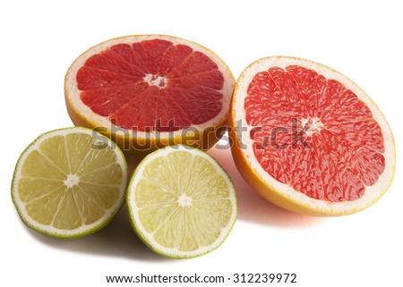 Freshly sliced halves lime and grapefruit isolated on white background.