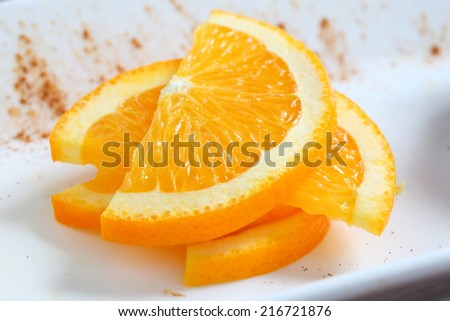 Freshly sliced oranges on  plate. Macro - stock photo