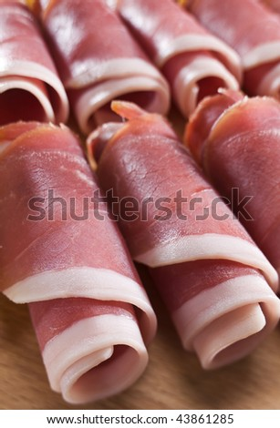 Freshly sliced prosciutto rolls close up shoot