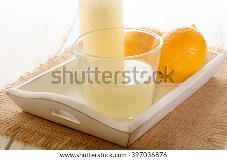 freshly squeezed lemon juice in a glass on serving tray