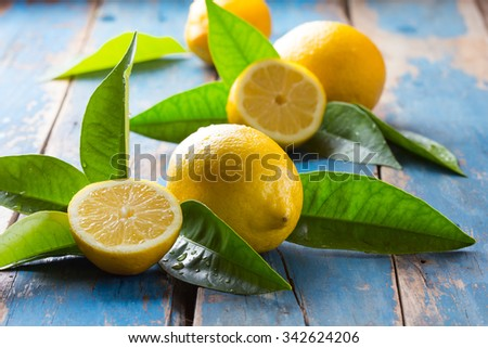 Freshly whole lemons on old wooden blue background