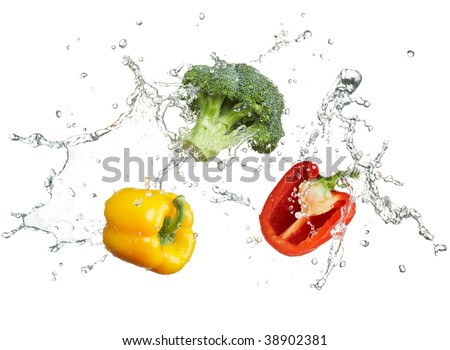 freshness of vegetables with water splash - stock photo