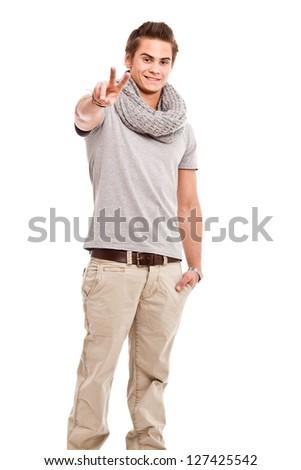Freundlicher Junger Mann zeigt Victory-Zeichen/Peace - stock photo