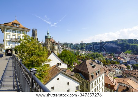 FRIBOURG, SWITZERLAND - SEPTEMBER 10, 2015: The capital city of the canton of Fribourg, located on both sides of the river Sarine which shares two linguistic regions between German and French cultures