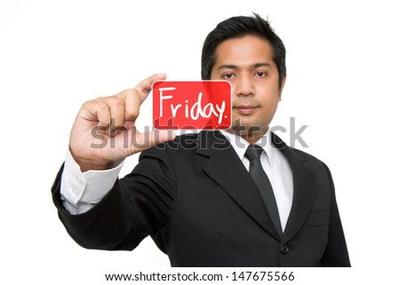 Friday. Business man holding friday  button