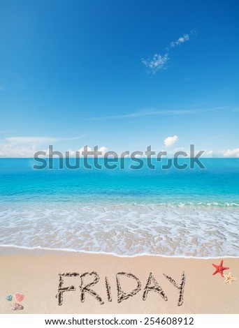 friday written on a tropical beach under clouds
