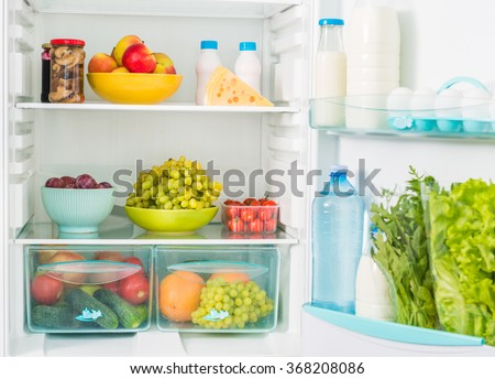 fridge inseide filled with different fresh food - stock photo