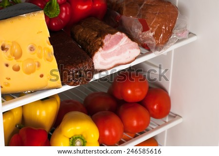 fridge with food - stock photo