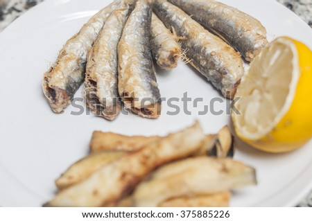 fried anchovies in clusters and fried eggplant - stock photo