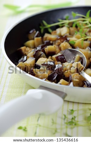 Fried Aubergines on the Pan - stock photo