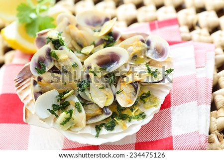fried bean clams in olive oil - stock photo