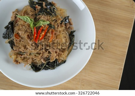 Fried Bean thread starch noodles in stir basil with Minced pork