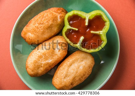 fried bread roll with potato stuffing inside, served with tomato ketchup or sauce, indian favourite bread fried roll or bread pakode or bread pakoda - stock photo