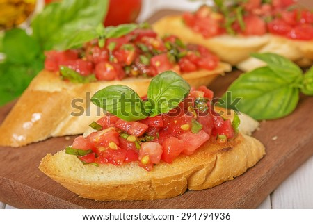 Fried bread with tomato and basil (bruschetta), close up