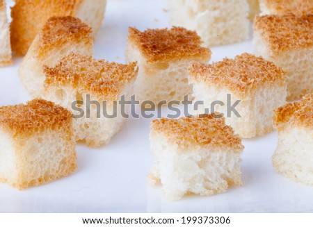 Fried brow pieaces of bread - stock photo