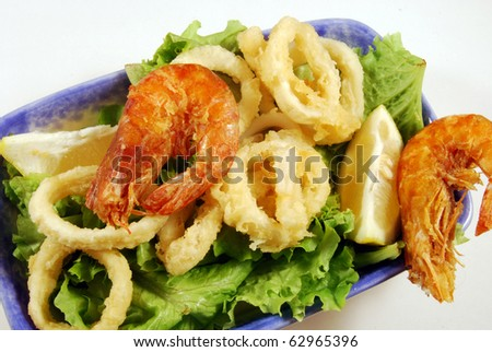 Fried calamari rings and shrimp nestled on a bed of lettuce