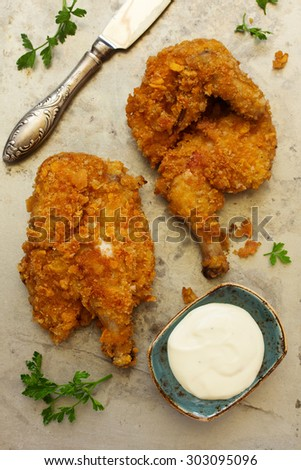 Fried chicken, breaded in corn flakes. - stock photo