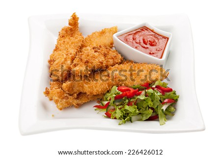 Fried chicken breast fillet in batter with vegetable salad on the plate . Isolated on white background.  - stock photo