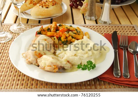 Fried chicken dinner with mashed potatos and rigatoni - stock photo