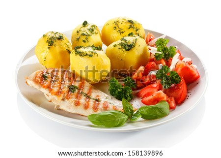 Fried chicken fillets, boiled potatoes and vegetables