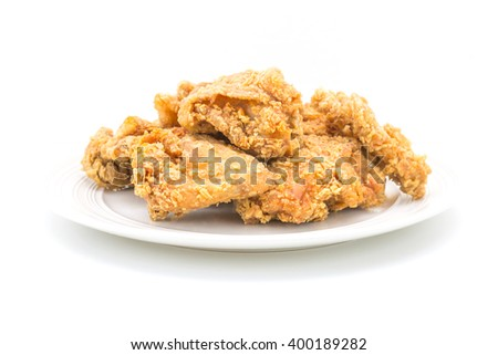 Fried chicken in white plate on white table, on isolate - stock photo