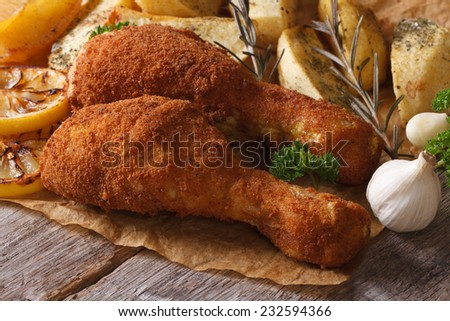 fried chicken leg in batter with potatoes closeup horizontal  - stock photo