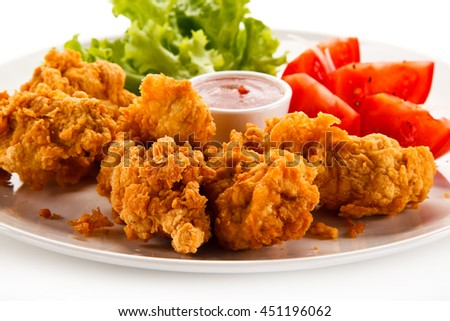 Fried chicken nuggets and vegetables  - stock photo