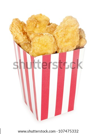 Fried chicken nuggets in red white striped box - stock photo
