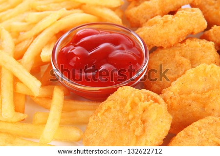 Fried chicken nuggets with french fries and sauce isolated on white - stock photo