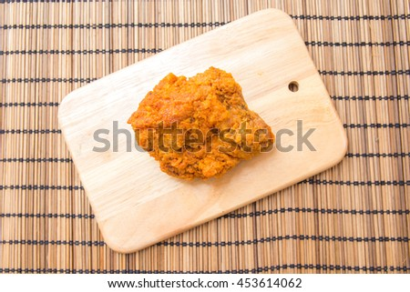 Fried chicken on wooden table