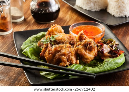 Fried chicken pieces in batter on a plate - stock photo