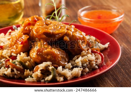 Fried chicken pieces with rice and sweet and sour sauce - stock photo