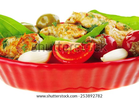 fried chicken pieces with vegetables on red - stock photo