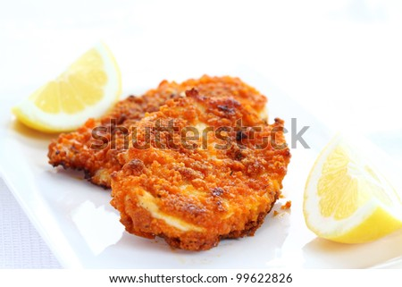 Fried chicken schnitzel with lemon - stock photo