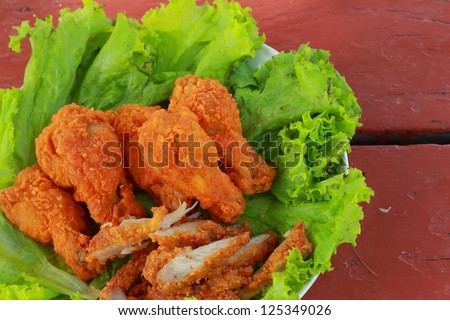 Fried chicken slices on lettuce. - stock photo