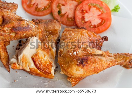 fried chicken wing with vegetables on white background.
