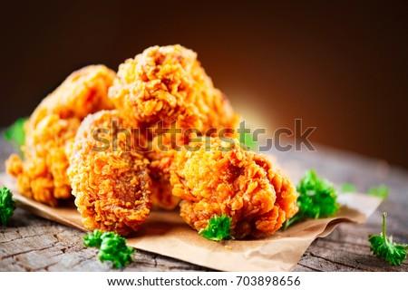 Fried Chicken Wings And Legs On Wooden Table Breaded Crispy Fried Kentucky Chicken Tasty Dinner