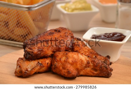 Fried chicken wings and sauce dip background. - stock photo