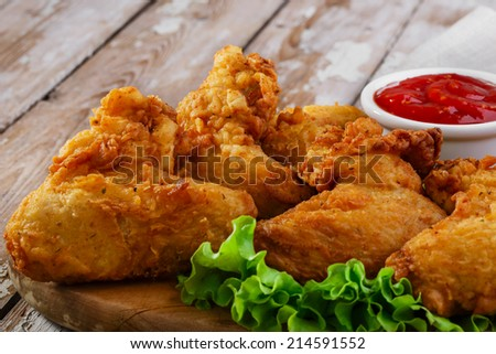 fried chicken wings in batter - stock photo