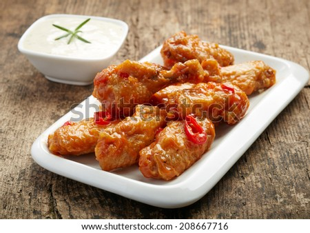 fried chicken wings with sweet chili sauce on white plate - stock photo