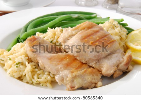 Fried chicken with herbed rice, and green beans - stock photo