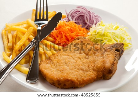 Fried chop pork and vegetable salad